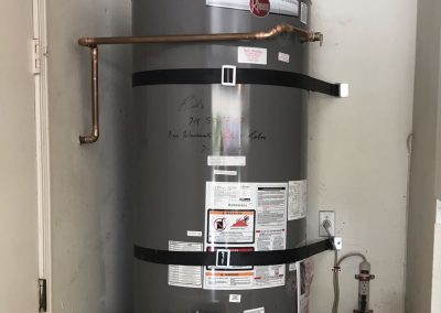 75 Gal Rheem Water Heater with Circulating Pump, new vent and new wood floor. City of Anaheim Hills, CA.